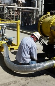 Delta Tech Services working on a pipe